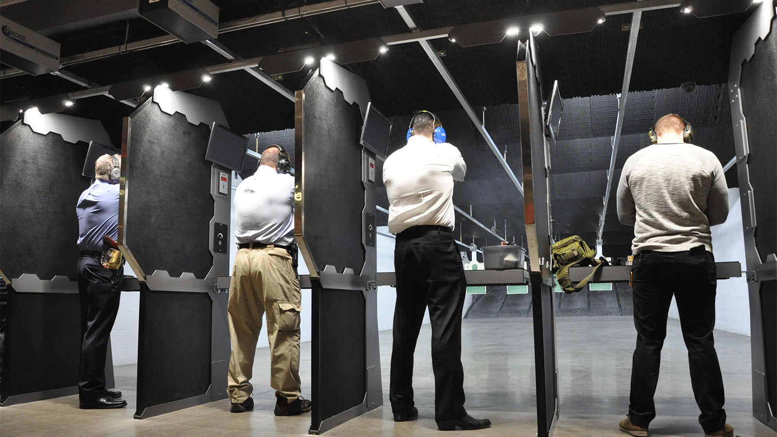 4 Saddle River Range Members shooting at Indoor Range in Conroe