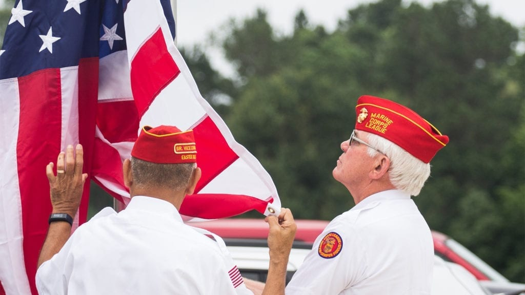 Two Marines raise the American Flag for Veterans Days at Saddle River Range